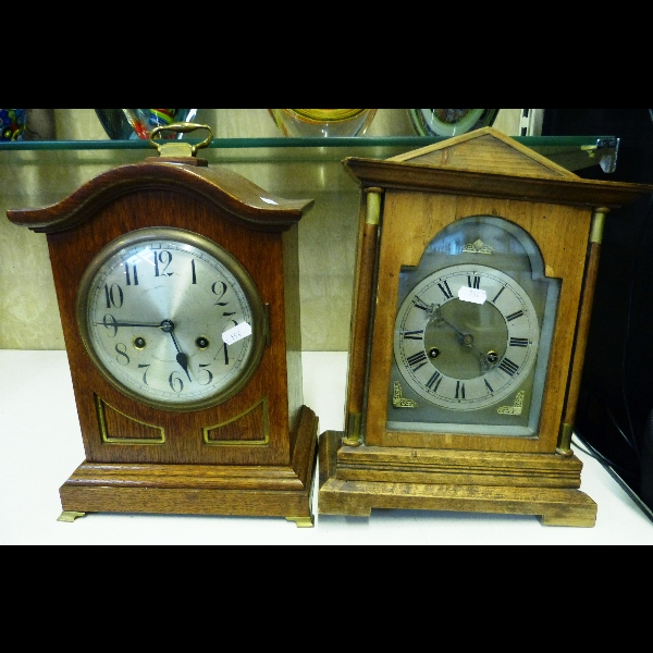 An oak cased mantel clock