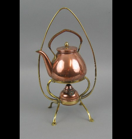 An Arts & Crafts brass and copper kettle