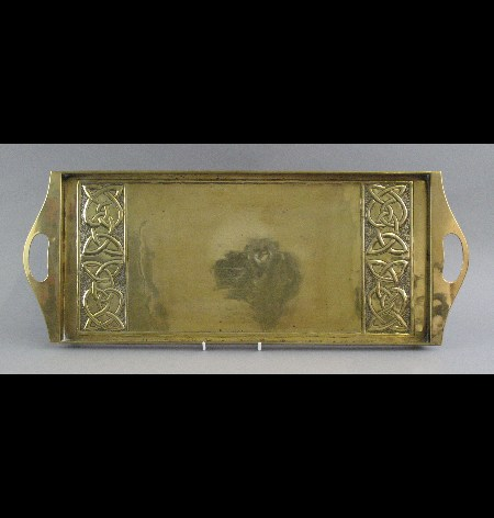 An Arts & Crafts brass two handled tray